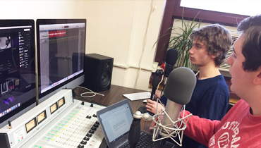 Students broadcasting radio program